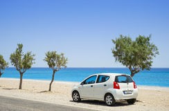 Car parked beside a deserted beach Royalty Free Stock Images