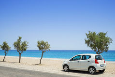 Car parked beside a deserted beach Stock Image