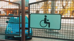 Car is parked for disabled people. Parking place sign for disabled on grey dark brick. people disabled concept lifestyle. Car parked for disabled people. Parking stock video