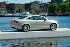 Car parked on a floating pier. Sportscar parked on a floating pier. The city-hall of Oslo, Norway in the background Stock Photos