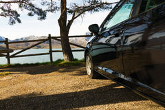 Car, Parked in front of Landscape Water and Mountains Stock Image