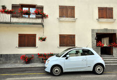 Car parked at the house. MORGEX, ITALY - JUNE 22: Small car parked at the house in Morgex on June 20, 2015. Morgex is a village in Val d'Aosta, Italy Royalty Free Stock Photography
