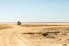 Car parked in the middle of the desert in Todos Santos, Baja California Royalty Free Stock Photos