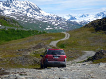 A car parked near a hiking path in alaska Royalty Free Stock Photo
