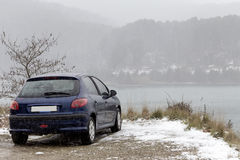 The car is parked near a mountain lake Royalty Free Stock Image
