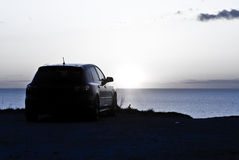 Car parked overlooking sunset Royalty Free Stock Images