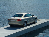 Car parked on a pier. Sportscar parked on a floating concrete pier Stock Photography