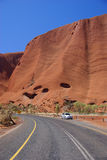 Car Parked on Road to Uluru. Holidaymakers stopped at the roadside in front of Australia's famous monolith, Uluru (Ayers Rock). Uluru - Kata Tjuta National Royalty Free Stock Photography