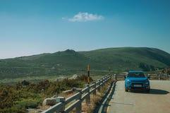 Car parked at the roadside on rocky landscape. Serra da Estrela, Portugal - July 14, 2018. Car parked at the roadside on rocky landscape, in the Serra da Estrela royalty free stock images