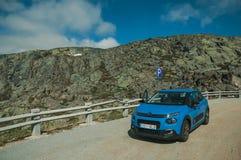 Car parked in the roadside on rocky landscape. Serra da Estrela, Portugal - July 14, 2018. Car parked in the roadside on rocky landscape, at the Serra da Estrela stock images