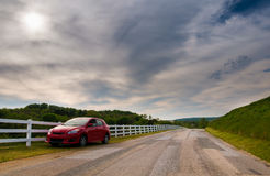 Car parked on the side of a backroad in Southern York County, Pe. Nnsylvania royalty free stock photography