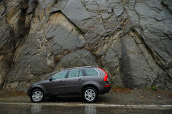 Car parked on side of road. Near a cliff Royalty Free Stock Image