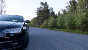 Car Parked on the side of the road - Drive safely concept Stock Photography
