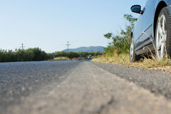 Car Parked by the Side of a Road in Rural Country. Ambush by Black Car on a Asphalt Road. Royalty Free Stock Photos