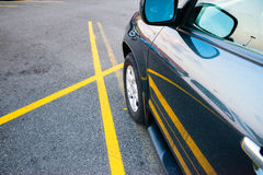 Car parked between single yellow lines Royalty Free Stock Photo