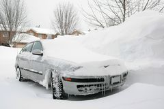 Car Parked in Snowy Driveway Royalty Free Stock Images