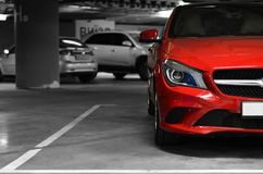 Car parked on underground parking. Side of red car on the underground parking Royalty Free Stock Images