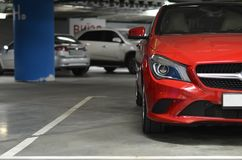 Car parked on underground parking. Side of red car on the underground parking Royalty Free Stock Photos