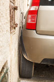 Car parked very close to wall Royalty Free Stock Photos
