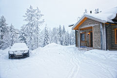 Car parked at a Wooden Cottage in Ruka in Finland in the Arctic Stock Images