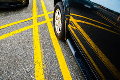 Car parked between yellow lines Stock Photo