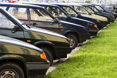 A car parking. An accurate car parking with a green grass Royalty Free Stock Photos