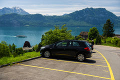 Car on parking against the lake Royalty Free Stock Images