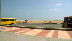 A Motorcycle, Car parking at Marina beach is the second longest beach in the World. Car parking area at Chennai Marina Beach.Marina longest beach stock video footage