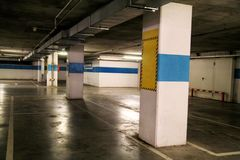 Car parking bar in the area in department store /  Parking lot, underground garage of shopping center. Car parking bar in the area in department store / Stock Photography