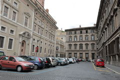 Car parking between buildings in Rome Royalty Free Stock Photo