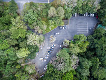 Car parking in forest, shallow depth of focus, top or aerial vie Stock Image