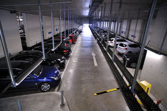 Underground parking filled with cars Stock Image