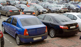 Car parking lot. Lot of passenger cars parking in city center urban scene crowded rush hour royalty free stock photos