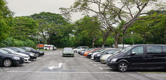 Car parking lot in Singapore. Singapore - Jun 22, 2015. Car parking lot at bus terminal in Singapore. The per-capita car ownership rate in Singapore is 12 cars Royalty Free Stock Image