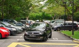 Car parking lot in Singapore. Singapore - Jun 22, 2015. Car parking lot at bus terminal in Singapore. The per-capita car ownership rate in Singapore is 12 cars Stock Image