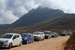 Car parking on mountain gravel road Stock Images