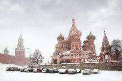 Car parking near Kremlin, winter. Car parking near Kremlin chiming clock of Spasskaya Tower in Moscow, Russia at wintertime during snowfall Stock Photos