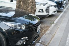 Car parking on pavement on Hanoi street, Vietnam. The city have issue lacking of car parking space.  Stock Photos