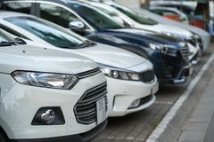 Car parking on pavement on Hanoi street, Vietnam. The city have issue lacking of car parking space.  Royalty Free Stock Image