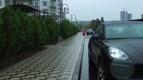 Car parking in the rain stock video