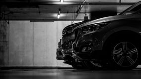 Car parking in shopping mall underground parking lot. Indoor car parking. Black and white scene of car parked at basement. Of building. Side view of SUV car Stock Photos