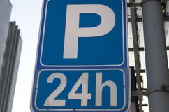 Car parking sign 24 hours a day royalty free stock photography