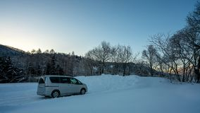 Car Parking On Snow Landscape royalty free stock images