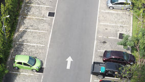 Car parking space and concrete road outdoor. Car parking space and concrete road outdoor and white arrow and top view angle Stock Photo