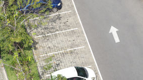 Car parking space and concrete road outdoor. Car parking space and concrete road outdoor and white arrow and top view angle Stock Photography