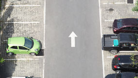 Car parking space and concrete road outdoor. Car parking space and concrete road outdoor and white arrow and top view angle Royalty Free Stock Photo