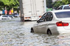Car parking on the street and show level of water flooding in Ba. Ngkok, Thailand Stock Photos