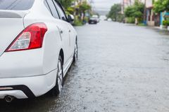 Car parking on the street of village while raining and show leve Stock Photo