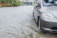 Car parking on the street of village while raining and show leve Stock Image
