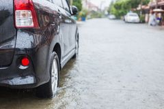 Car parking on the street of village while raining and show leve Royalty Free Stock Photography